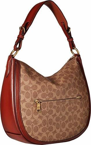 5f6f01d66fe5 ... COACH Women s Coated Canvas Signature Sutton Hobo Tan Rust